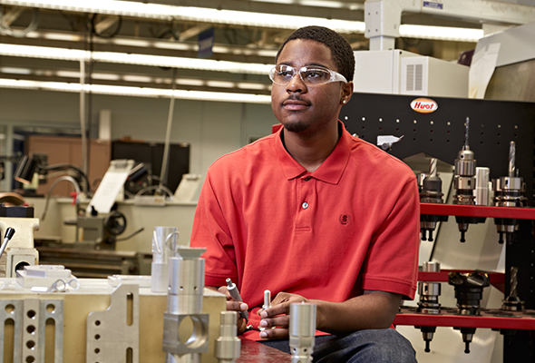 Photo of a young man working in a manufacturing facility