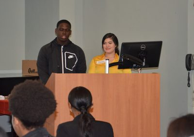 Photo of two students at the podium at the HSIP event